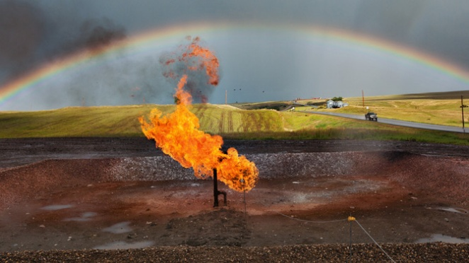 A natural gas flare in North Dakota. A rainbow appears to arc over it. An image of hope, or of despair?